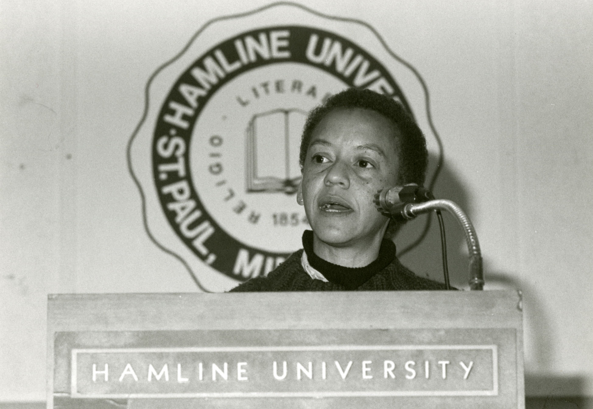 unidentified woman at podium