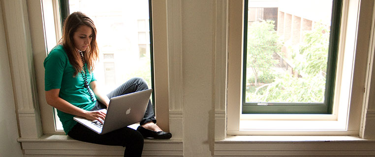 Student in Window with Laptop